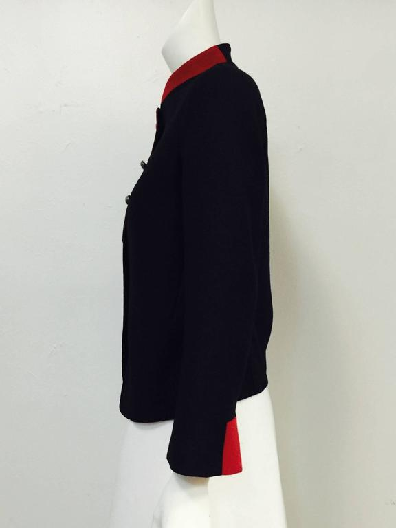 Nili Lotan Jacket Black Jacket pays homage to the military!  Features, luxurious wool and cashmere blend fabric, contrasting red Nehru collar, piping, and sleeve cuff accents and hammered silver tone buttons.  Fully lined.  Sleeve lining crafted