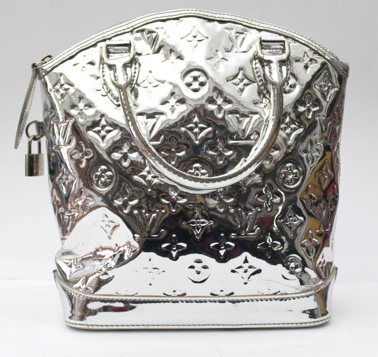 ef2989332469 This Louis Vuitton Limited Edition Silver Monogram Miroir Lockit bag is a  gorgeous and glamorous bag