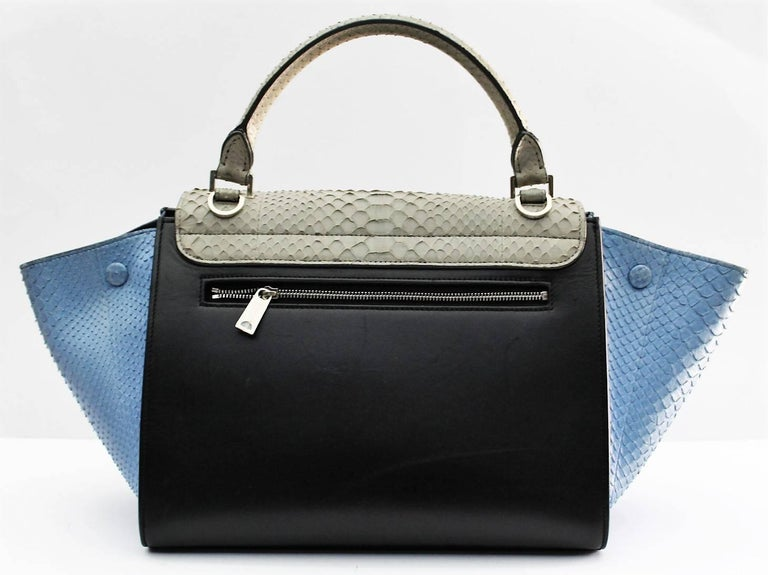 One of the newest installments of the Celine brand, the Trapeze bag is a gorgeous combination of a box flap and the signature luggage-tote style wings.