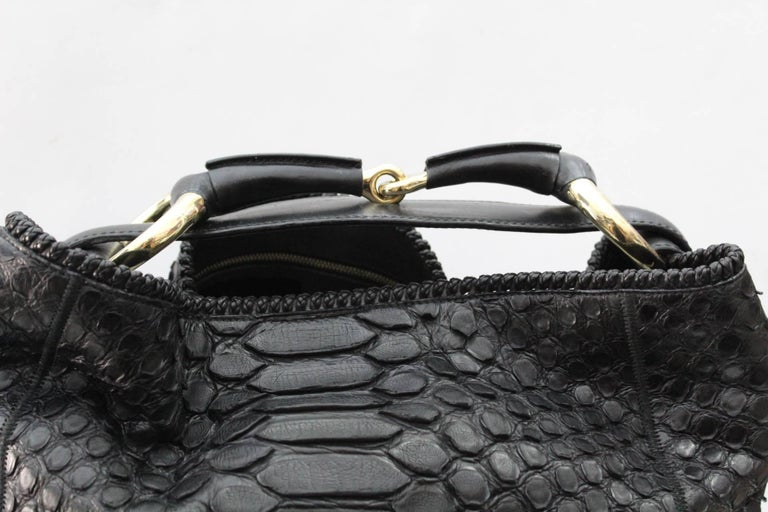 0ef397db04ee77 Gucci Horsebit Hobo is constructed with rich black python skin. The interior  is also equipped