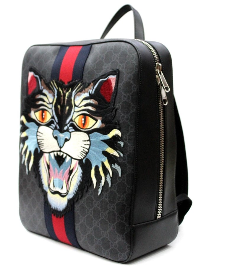 The snarling cat head is embroidered and applied to a structured backpack made in GG Supreme canvas with Web stripe. Black/grey GG Supreme canvas, a material with low environmental impact, with black leather trim Palladium-toned hardware Blue and