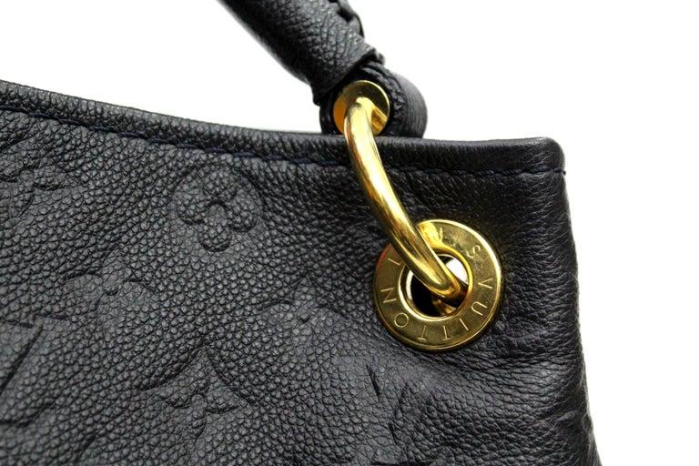 7efb616e50e5 The Louis Vuitton Monogram Empreinte Leather Artsy MM Bag has a unique and  modern structure.