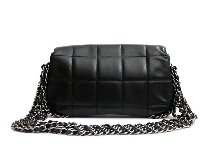 Black leather and cotton multiple chain logo shoulder bag from Chanel Vintage featuring a flip-lock closure, a quilted effect, a silver tone logo, a chain strap and internal pockets Very soft black lambskin. Wearable on the shoulder. The bag is in