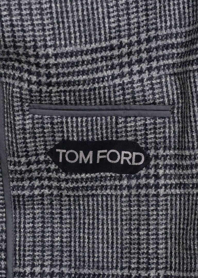 Step into the season in your durable Tom Ford Sports Jacket. This high quality Wool Jacket piece features classic Shelton Cut, 100% Wool, Houndstooth Pattern  2 Button and Single Vent. Pair this streamlined modern classic Jacket with black skinny