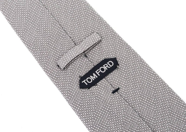talian luxury brand, Tom Ford, has crafted these gorgeous 100% Silk Tie for important special occasions and professional events. The tie is great to pair with your favorite solid color button down and blazers with your chosen pair or classic