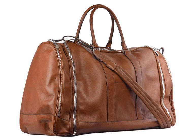 Brunello Cucielli Brown Travel Garment Bag. This versatile garment bag features a detachable interior with two mesh zip up compartments and two magnetic snap pockets . With a hanger hook this is the perfect compact garment bag for any