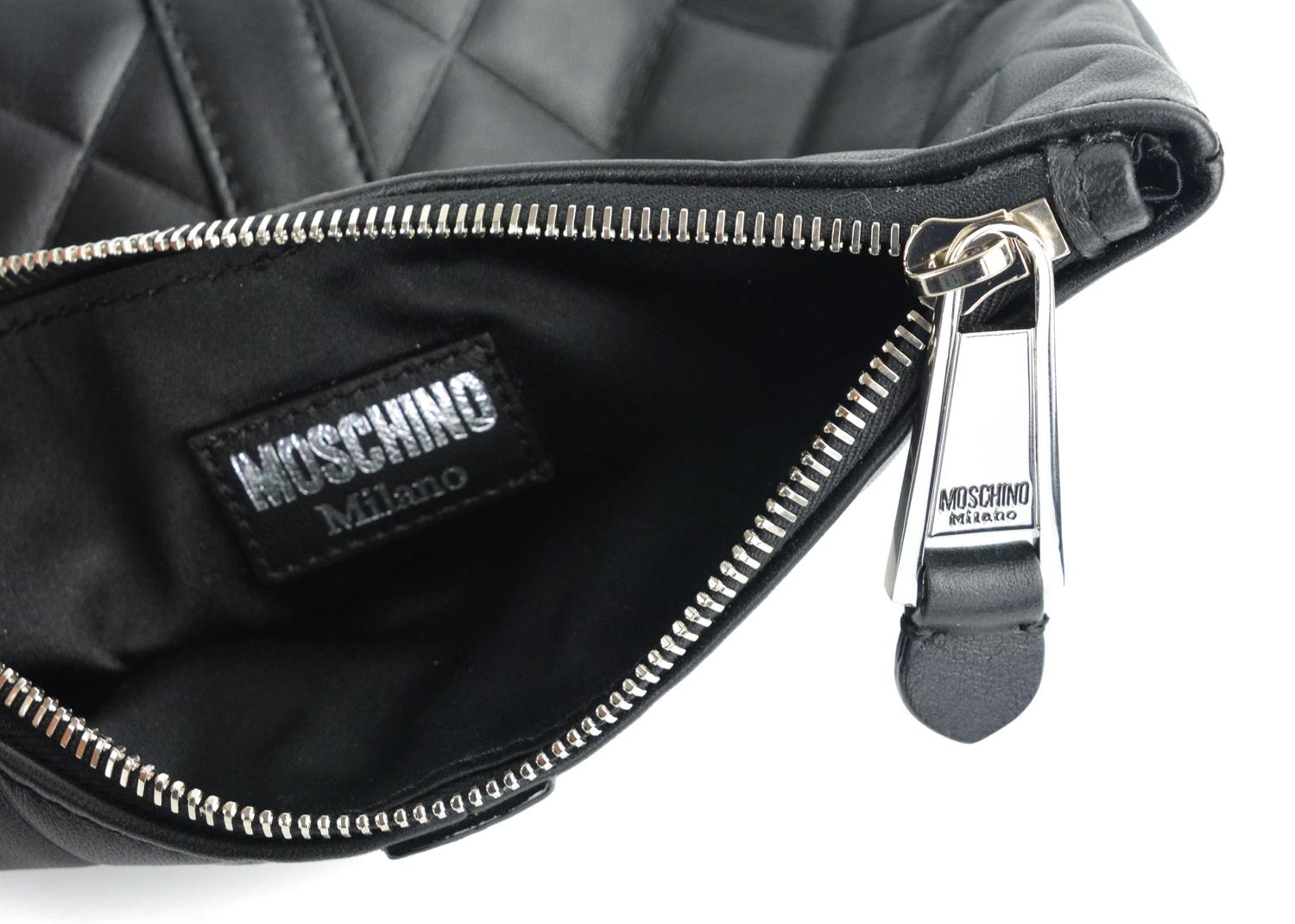 a5246b7389 Moschino Womens Quilted Logo Clutch Black Leather Wristlet For Sale at  1stdibs