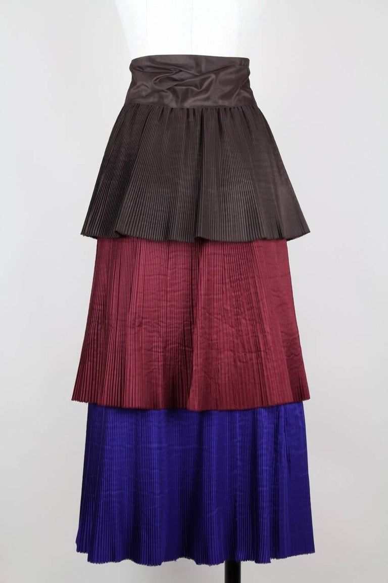 This is a rare and collectible 1980s vintage Yves Saint Laurent Rive Gauche pleated tiered skirt with a long 8 cm - 3.1