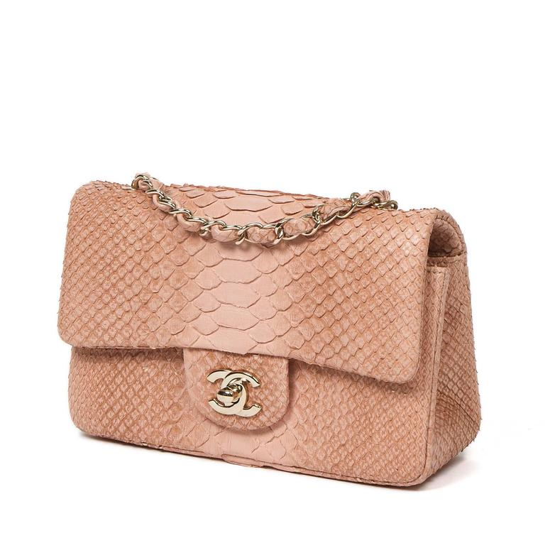 "Mini Flap Bag in soft pink python skin, long chain strap interlaced with python skin and signature CC turlock, champaign gold hardware. Back slip pocket. Tan leather lined interior with one slip pocket and zip pocket. Metal plaque signed ""Chanel"" """