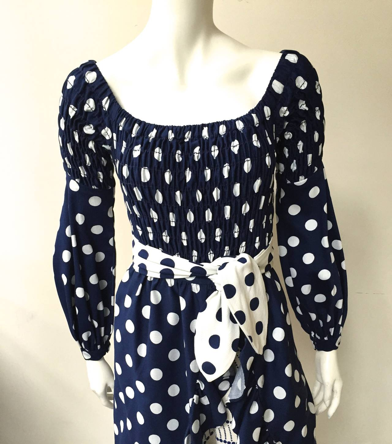 This Oscar de la Renta 3 piece polka dot dress with pockets was designed in 1970 and by January 1971 it appeared on the cover of Harper's Bazaar. Oscar de la Renta Boutique dress with over skirt and matching self tie belt. This is a fantastic mix of