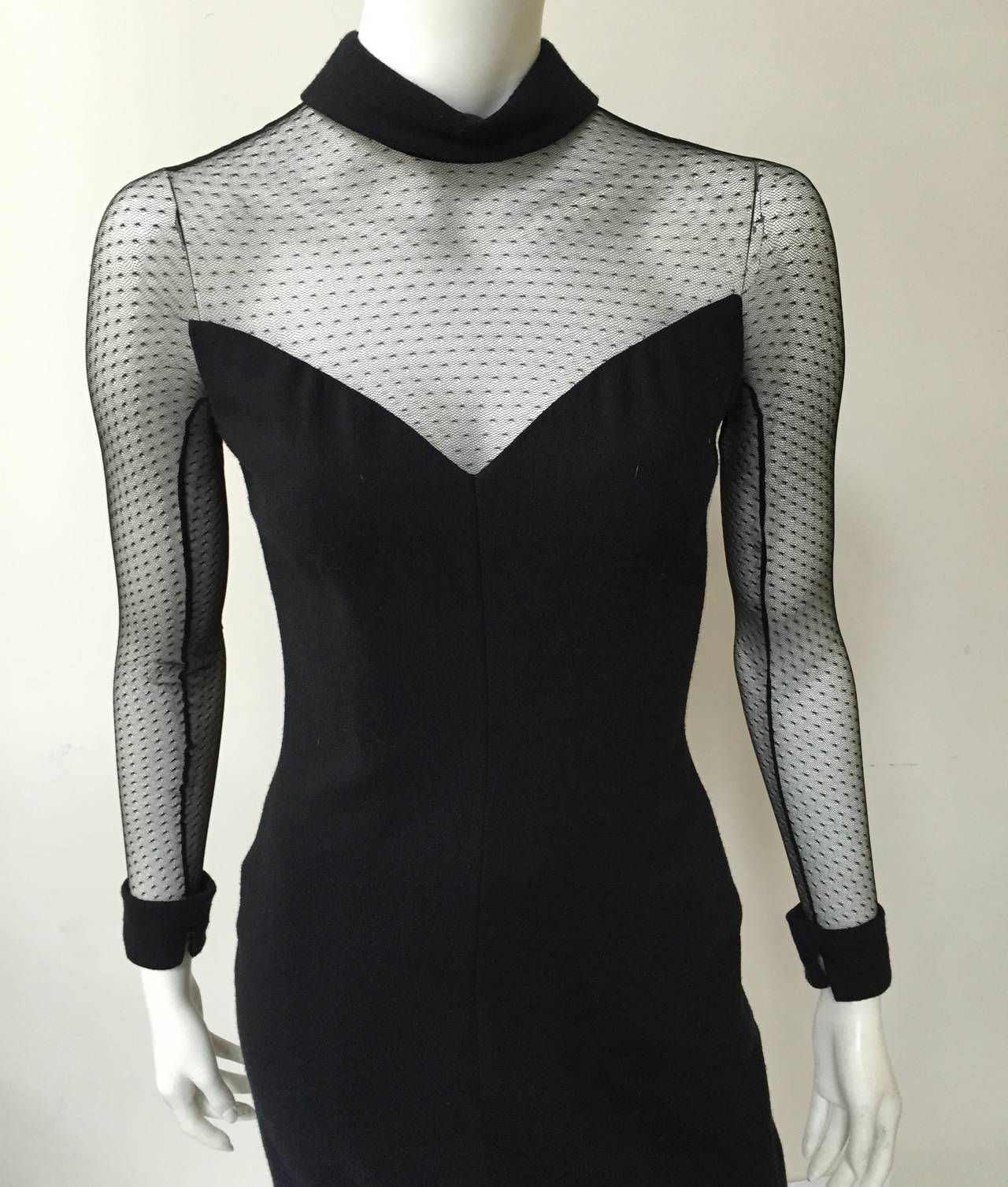 Scaasi Boutique 80s black wool cocktail size 4 dress with netting at neckline, sleeves and back. There are 4 black bows that hook and attach back of dress. This dress came from Isaacson's which was a very elegant store in Atlanta catering to high