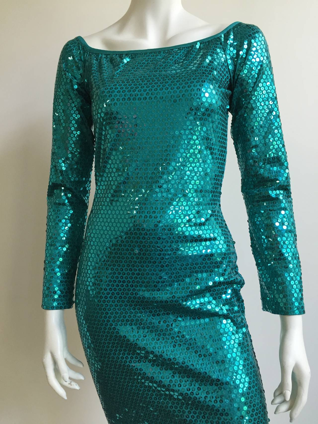 Patrick Kelly Paris 1980s turquoise evening dress size 4 ( please see & use measurements). This dress is from the collection of Carol Martin who was Patrick Kelly's friend & model in the 70s & 80s. During their long friendship Patrick Kelly gave