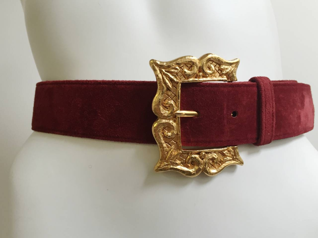Christian Lacroix 1980s burgundy suede belt with classic Lacroix gold frame buckle size 38 fits like a size 4 ( Please see & use measurements to measure your waist to see if this belt works for you). 