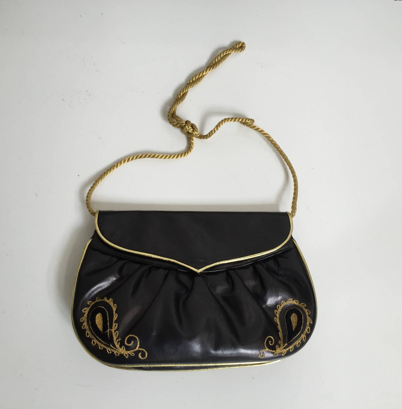 Barbara Bolan 1980s black leather embroidery paisley shoulder / clutch handbag gold trim &  made in Italy.  Barbara Bolan designs can be seen in The Metropolitan Museum of Art permanent collection. Interior has one zipper compartment. Measurements
