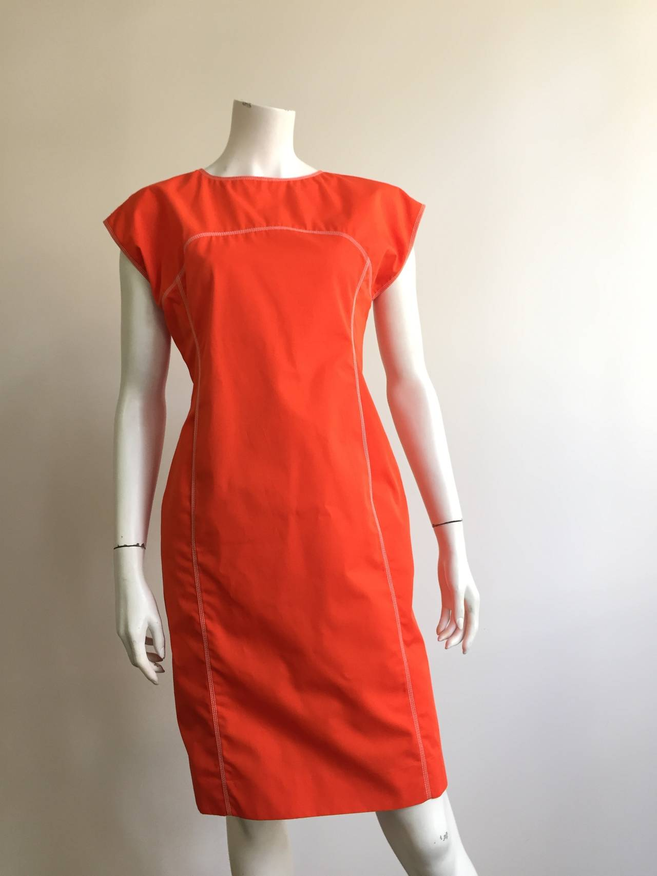 Courreges Paris 1980s orange dress with front pockets original size 40 but could fit a size 8.  Please see & use measurements to measure your body to make sure this will fit you perfectly.