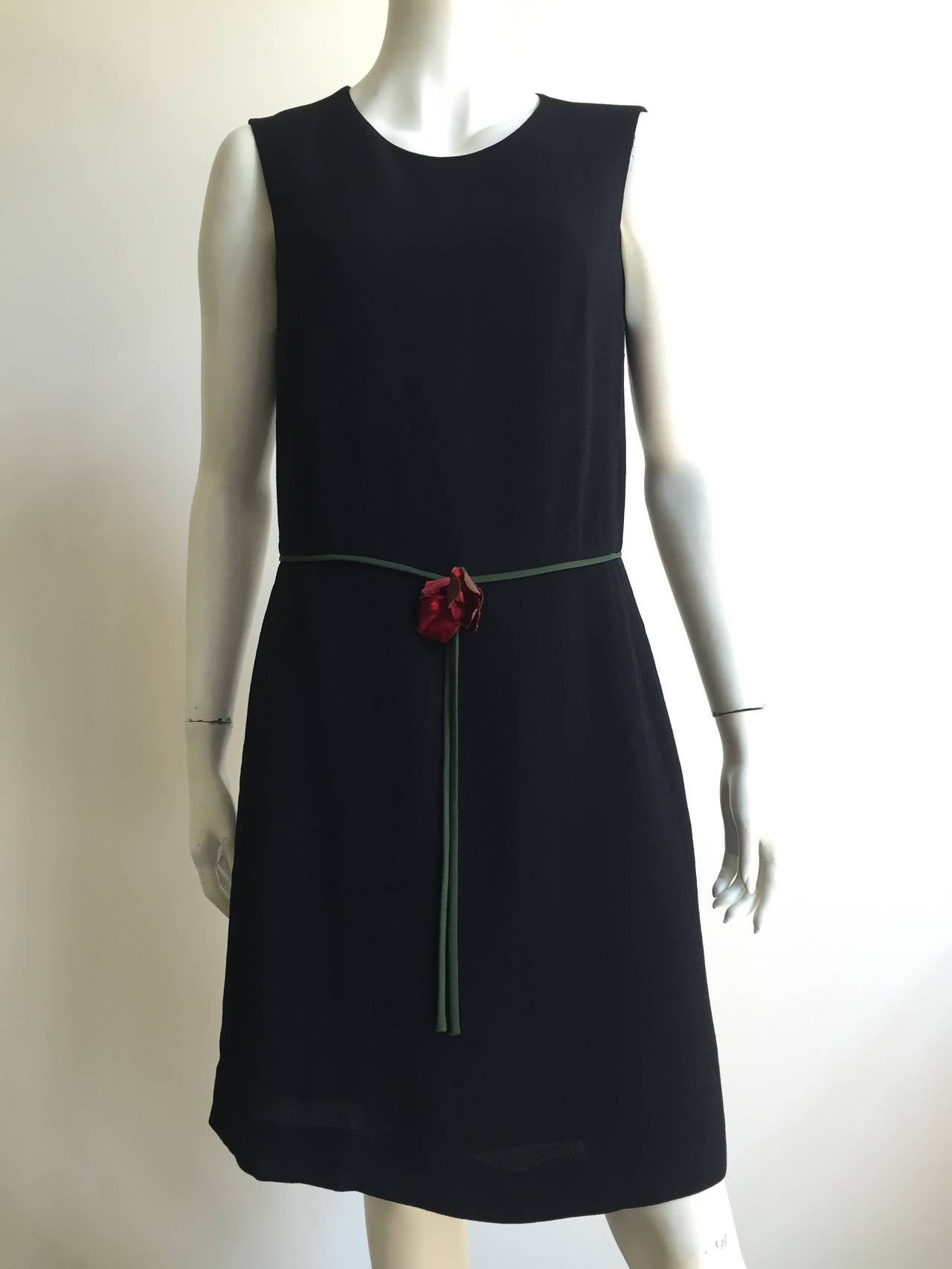 Cheap and Chic by Moschino black wool with rayon shift dress size 12. Please see & use your measuring tape to measure yourself. Red fabric flower at waist that elevates that simple LBD.  Measurements are: 39