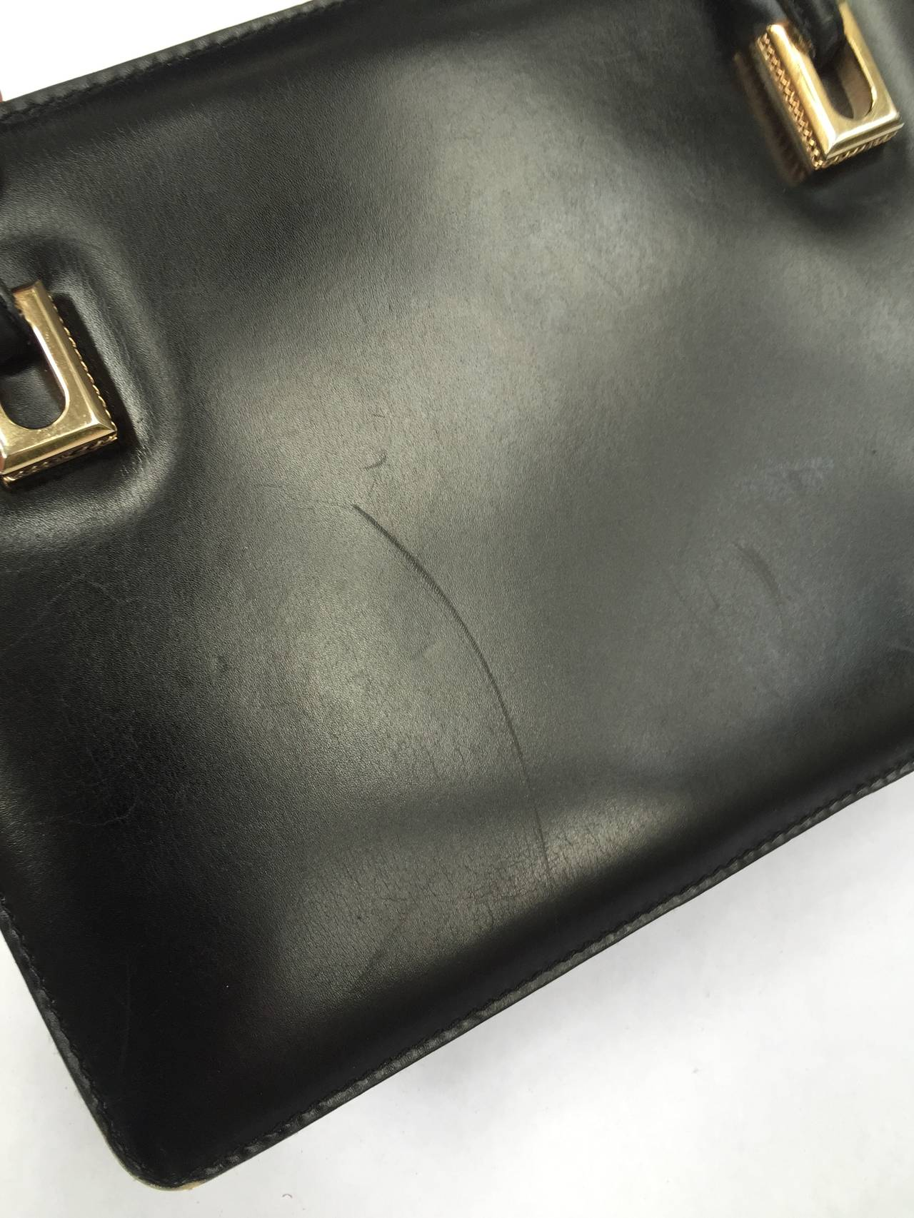 Loewe 1960s black leather handbag. Classic & iconic Loewe vintage black leather handbag has outer side compartments. Interior compartments have extra space and zipper compartment.