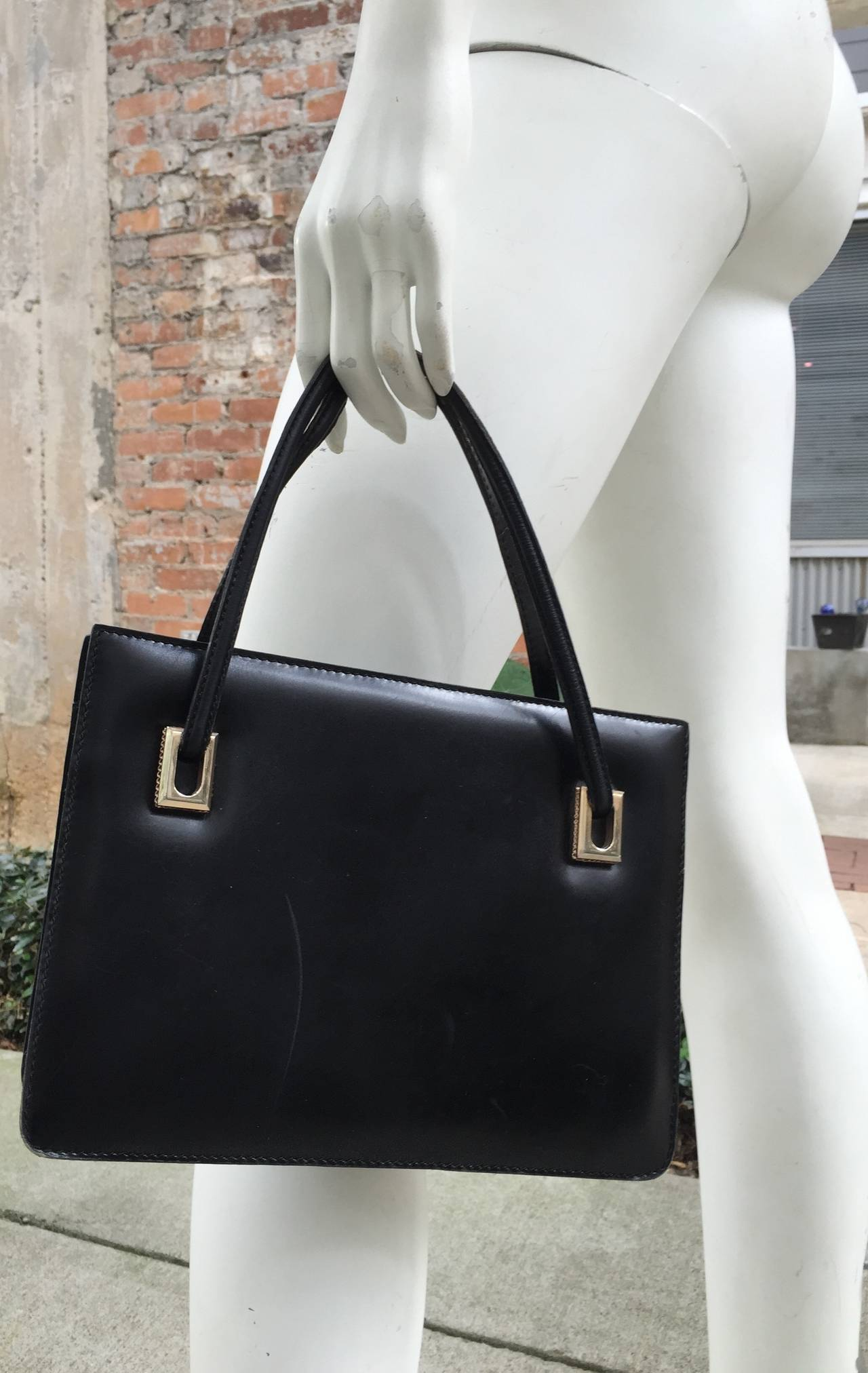 Loewe 60s black leather handbag. 9