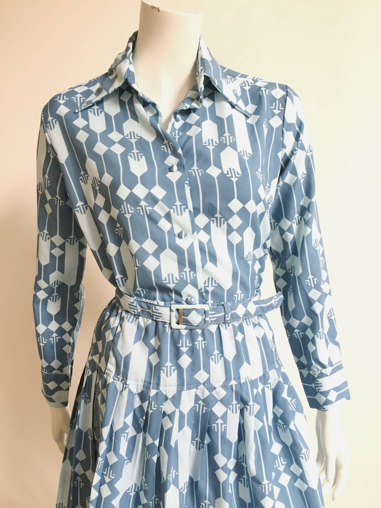 Lanvin 1970s 3-piece set; blouse, skirt & belt with Lanvin logo will fit a USA size 8.  Please see & use measurements I provide so that you know for sure it fits you to perfection. Fabric covered buttons. Skirt has elastic waistband. Skirt
