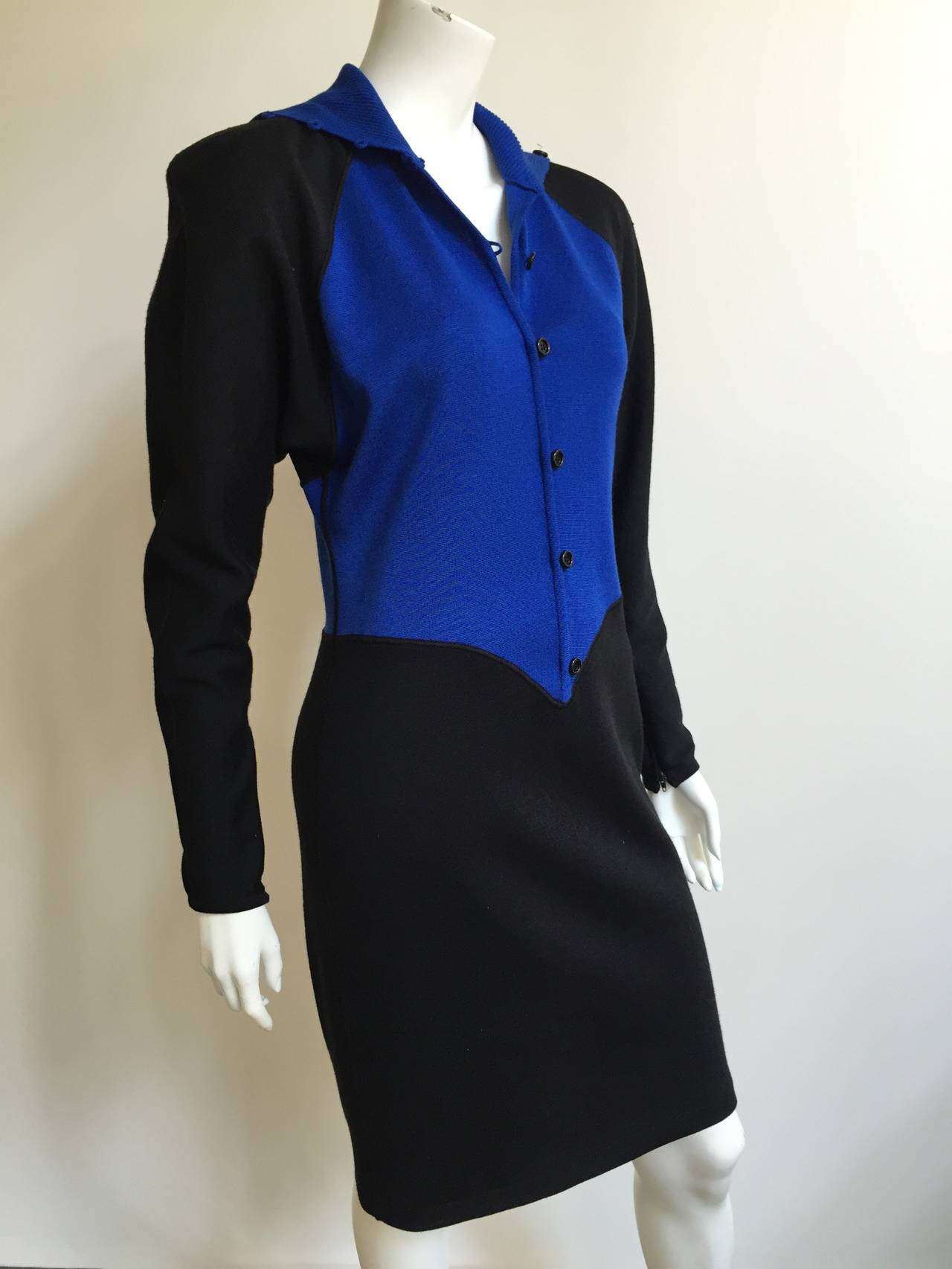 Emanuel Ungaro Parallele Paris 1980s knit dress with dolman sleeves is a vintage size 12 but fits like a modern USA size 8 ( Please see & use measurements to properly measure your lovely body).  Button up turtle neck. Shoulder pads as shown in