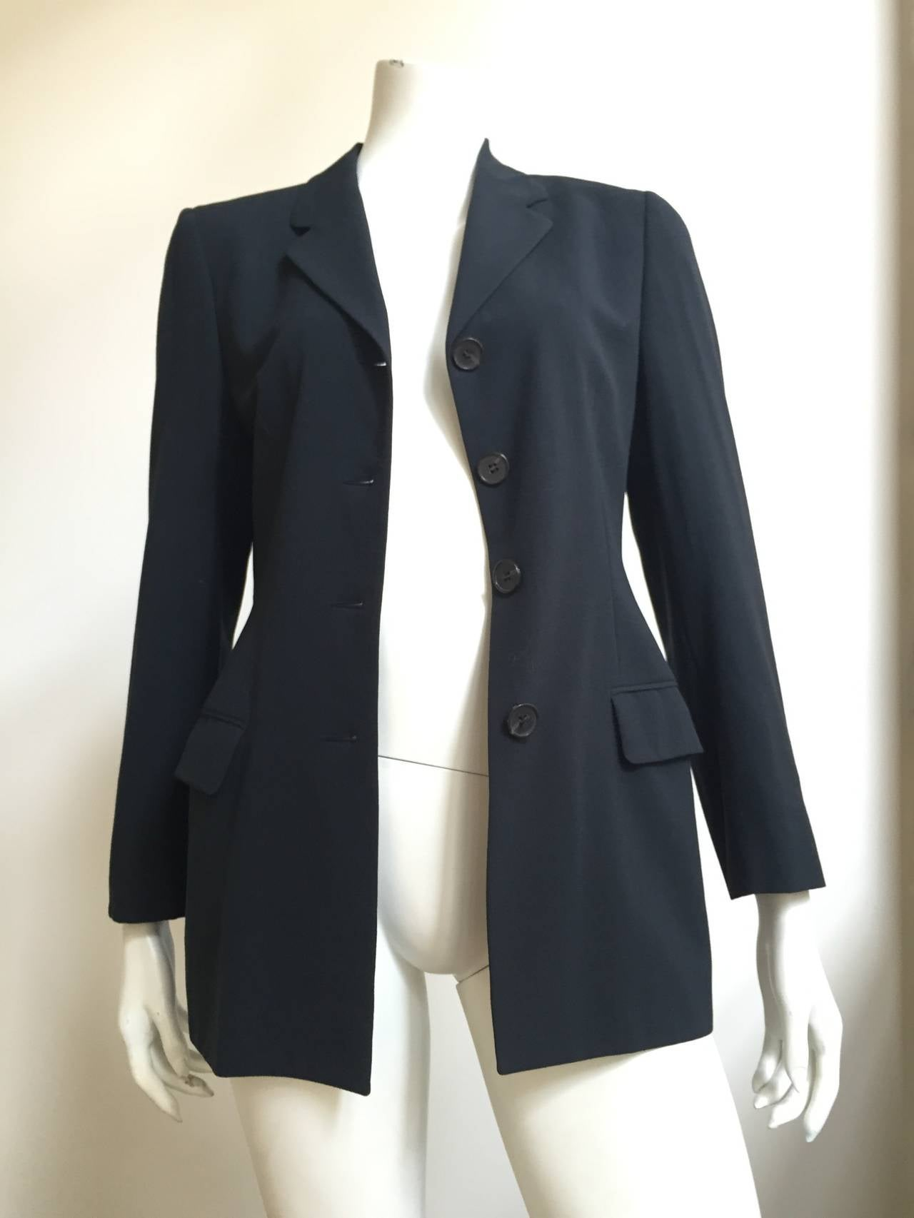 """Loro Piana four button charcoal gray wool jacket is a size 8 / 42. Known for using only the best fabrics this Loro Piana jacket is timeless. Measurements are: 37"""" bust 23"""" sleeves 29. 1/2"""" jacket height."""