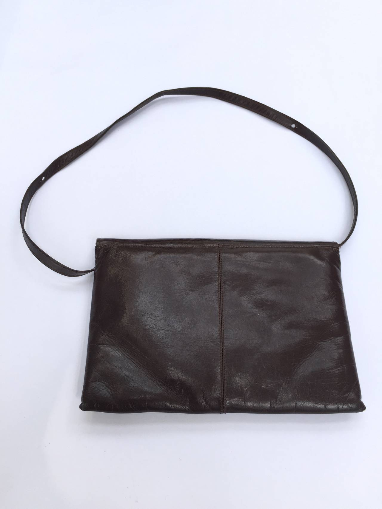 Charles Jourdan 1970s brown leather with stitched logo shoulder / clutch handbag. Straps are removal for when the clutch is needed.