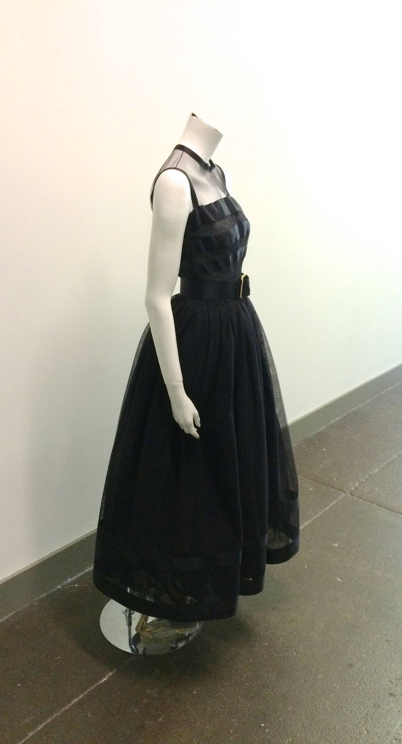 """Chanel black ball gown size 34 purchased in Atlanta at the Chanel boutique in 1985 to wear to a Russian Ball at the Plaza Hotel in New York City. Black silk with layered tulle fabric.  Dress size is 34 and belt size is 36. Belt is 24.5"""" long and 2"""""""