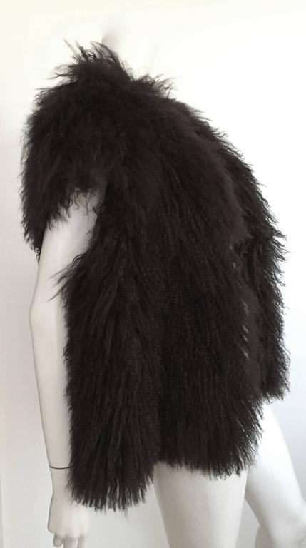 Sonia Rykiel Mongolian fun fur vest fits this size 4 mannequin perfectly but will also fit a size 6 / 8 as well but please see & use the measurements below so that you may properly measure your lovely body. This fur vest is timeless and goes with