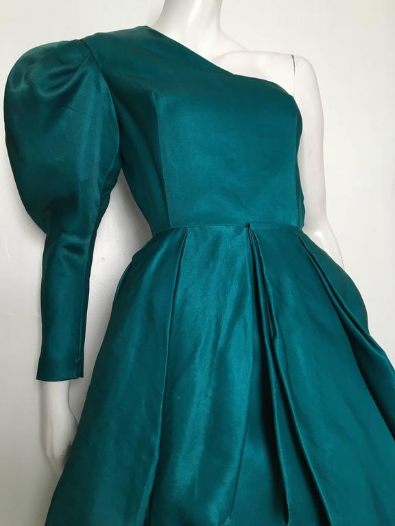 Tan Giudicelli 1980s teal silk dramatic one shoulder evening gown is a vintage French size 38 but fits like a modern USA size 4.  Please see the measurements listed below so you can properly measure your lovely body to make certain this gown will