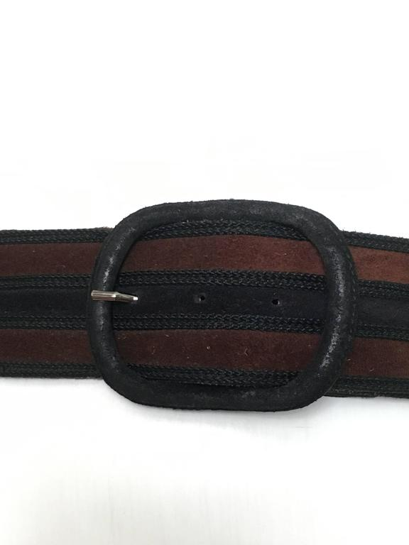 Yves Saint Laurent 1980s black brown leather belt.  Belt is marked medium but fits like a small and this is a waist belt not a belt that goes through the loops.  Belt is 31