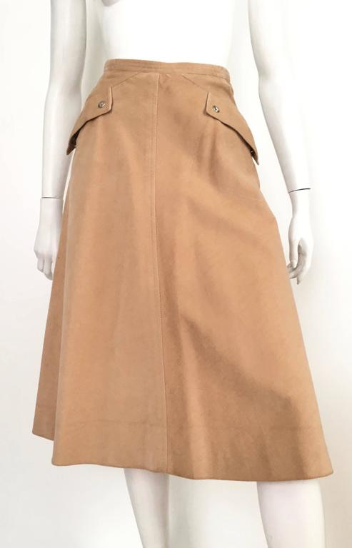 Courreges Paris khaki corduroy a-line two front pockets with logo snap buttons skirt is a size 4.  This fits Matilda the Mannequin perfectly and she is a true size 4, so if you and Matilda have the identical body then it's a green light.  Please use