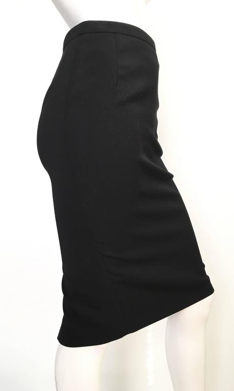 Gucci 2013 black wool pencil skirt is an USA size 4 and an Italian size 38.  Ladies please grab your trusted tape measure so you can measure your waist & hips to make certain this sexy Gucci skirt will fit you to perfection. The skirt is made