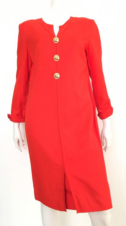 Carolina Herrera 1980s red orange raw silk dress is a size 10.  Ladies please grab your trusted tape measure so you can properly measure your bust, waist & hips to make certain Mrs.Herrera would approve. This gorgeous eye popping dress is fully