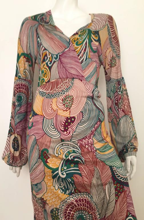 M Missoni abstract pattern jersey knit dress with long peasant sleeves is a size 6.  Ladies please grab your best friend, Mr. Tape Measure, so you can properly measure your bust, waist, hips & sleeves to make certain this will fit your lovely