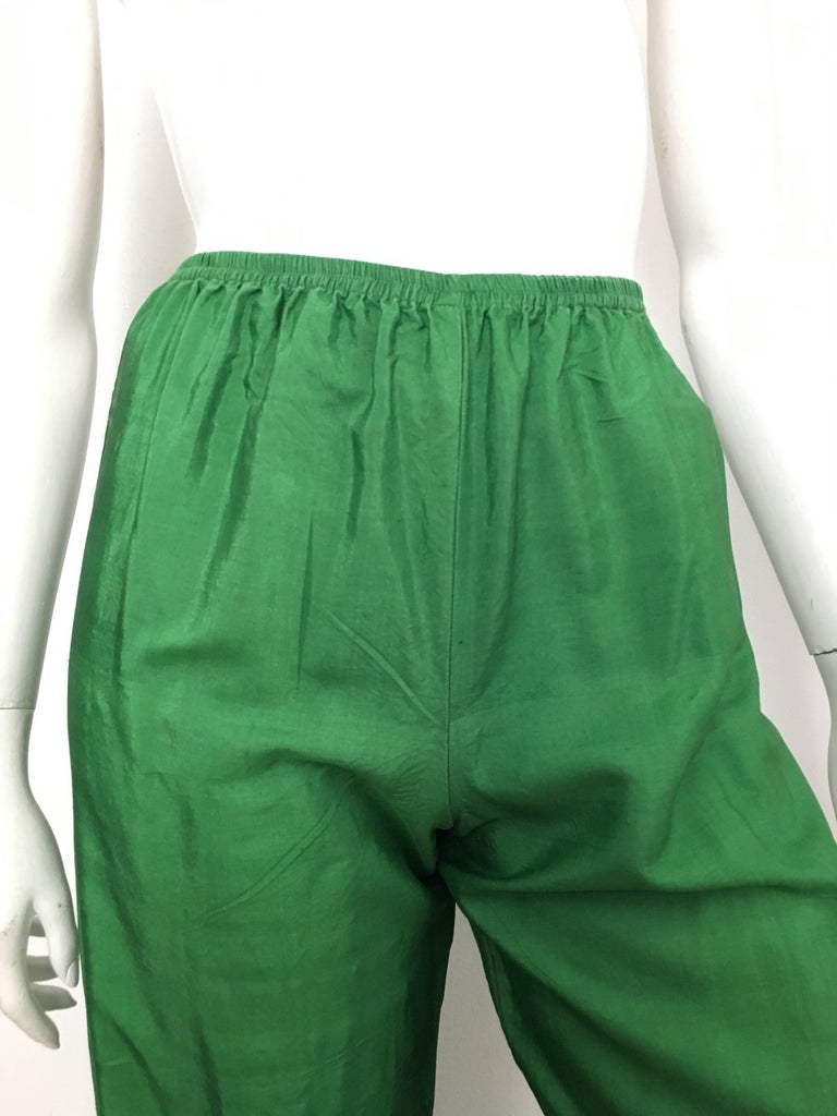 b66709ea70a2 Saint Laurent Rive Gauche 1970s green silk pants with elastic waist band is  a French size
