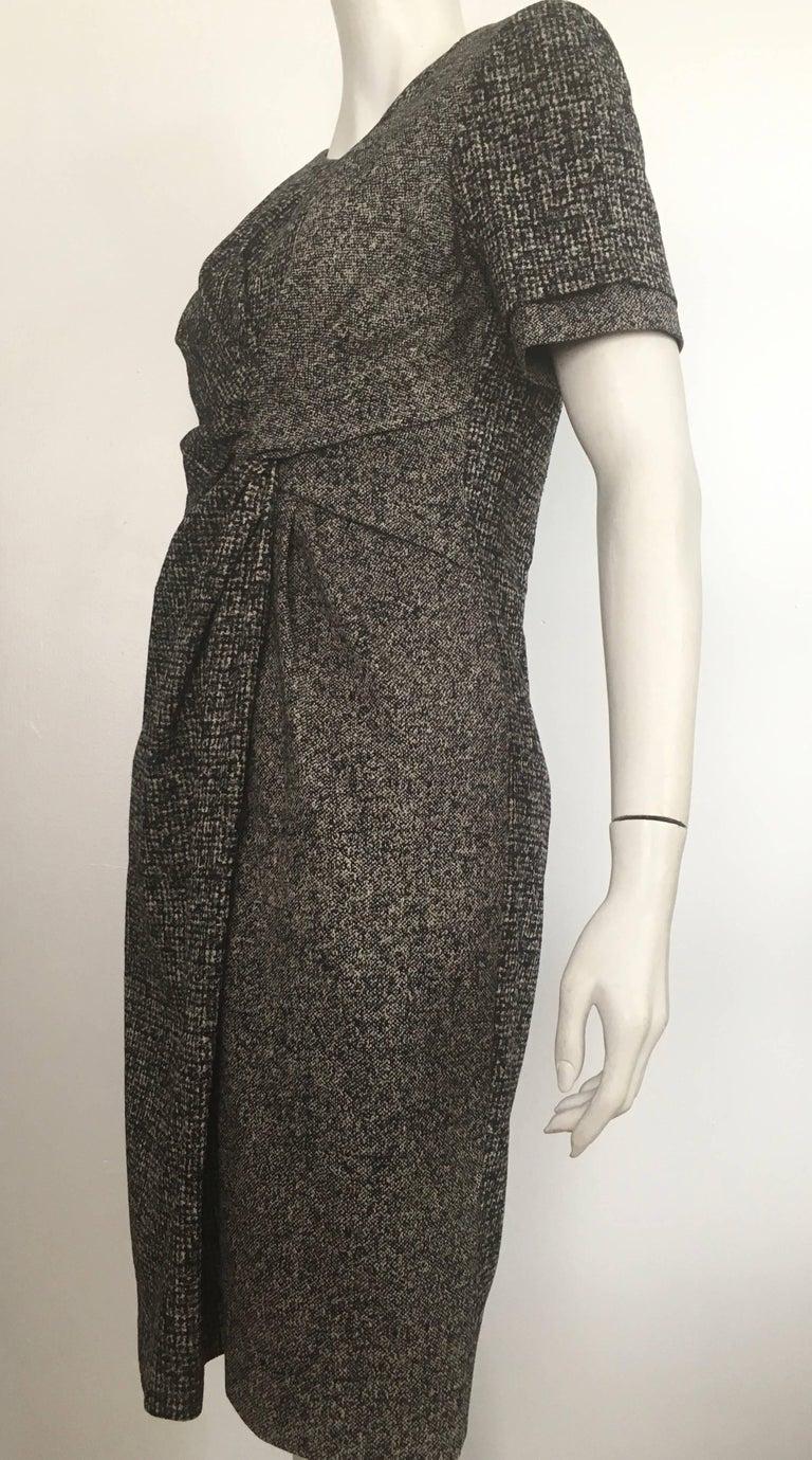 Paule Ka cotton black & grey short sleeve casual dress is a size 42 and fits like an USA size 10 / 12.  The waist is 34