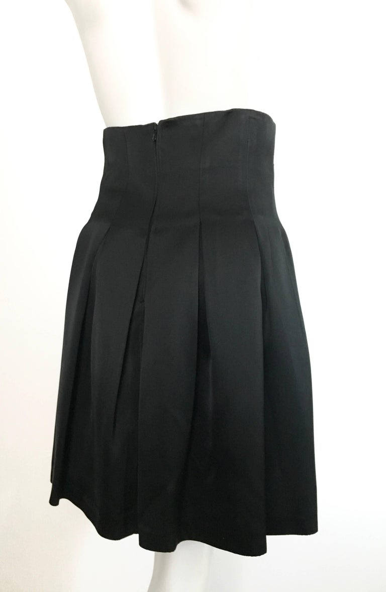 Women's or Men's Patrick Kelly Paris 1980s Black Pleated Skirt Size 6. For Sale