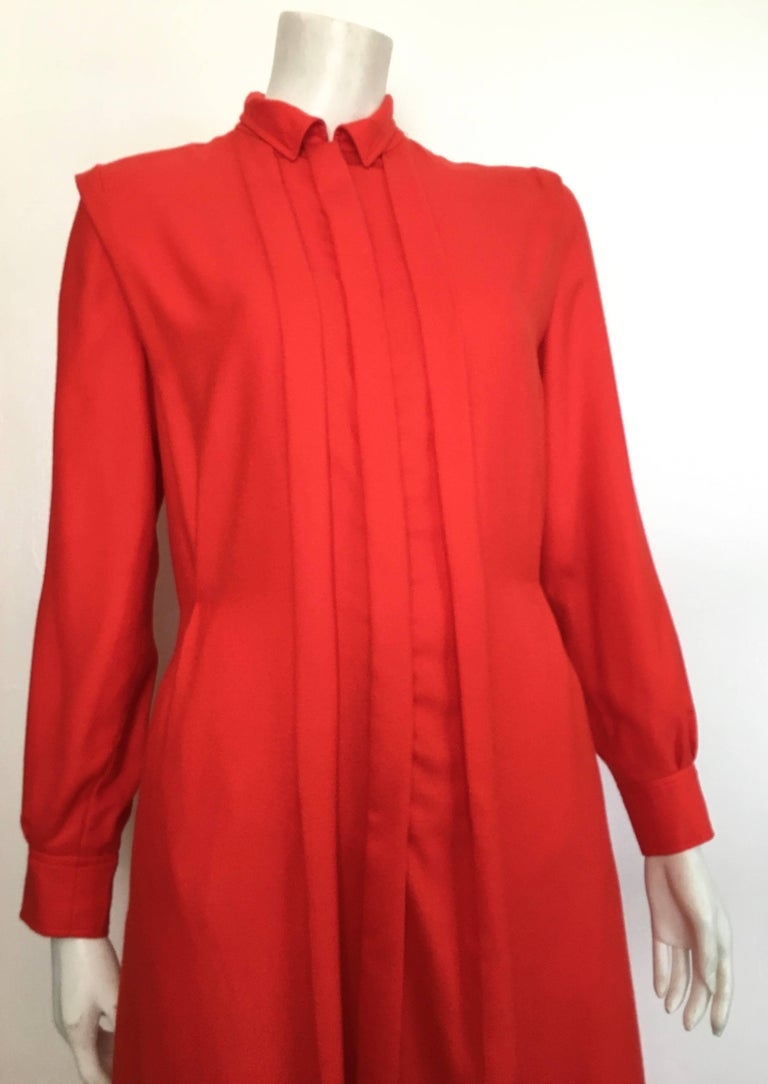 Courreges Paris 1980s fire engine red wool long sleeve dress with pockets is a size 8. The waist on this dress is 32