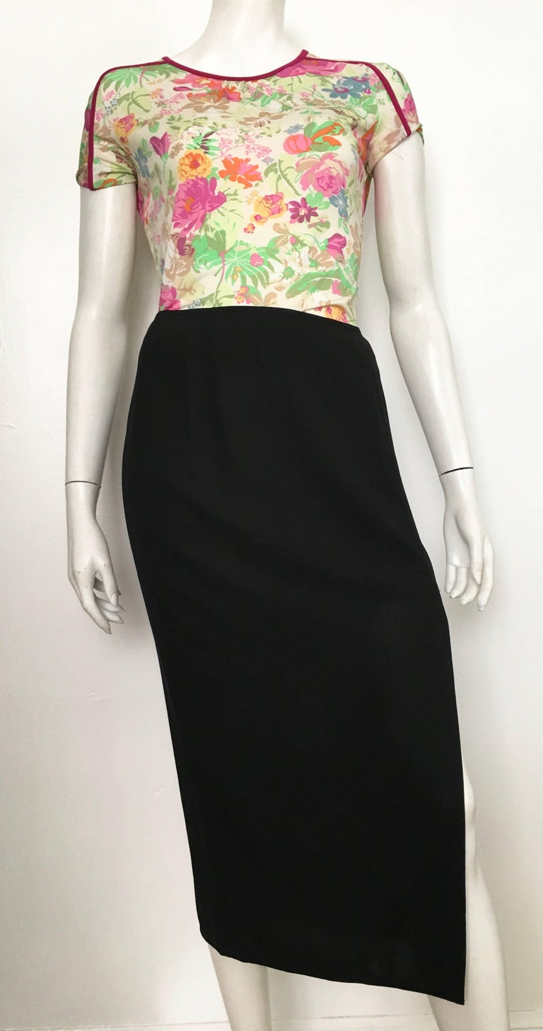 Donna Karan 1990s long black wool with sexy slit skirt, made in Italy, is a size 6. The waist on this skirt is 31