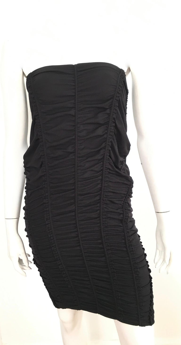 Donna Karan New York 2000s black parachute dress is labeled a size 8 but fits more like a size 6. There is an elastic band around the top part of dress. Italian fabric is wool, nylon & spandex.  This show stopper dress is just stunning, it has the