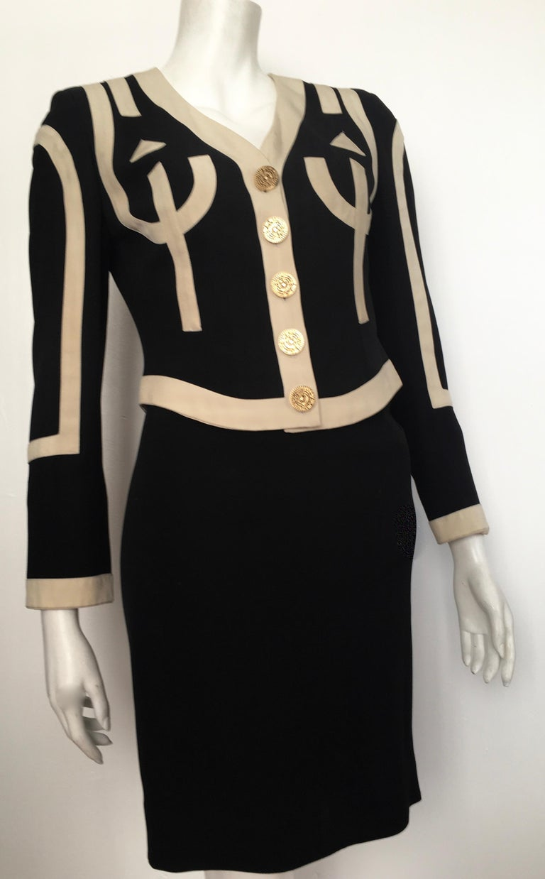 Moschino Cheap & Chic 1990s black & cream jacket & skirt suit made in Italy. The jacket is a labeled a size 6 and the skirt is labeled size 4.  The waist on the skirt is 24. 1/2