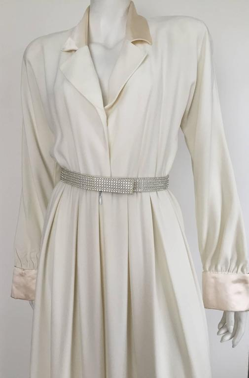 Carolyne Roehm 1980s elegant cream wool crepe tuxedo jumpsuit with rhinestone belt size 4. Silk collar - lapel  - cuff give this very chic jumpsuit its sophisticated look. Shoulder pads and is completely lined. 