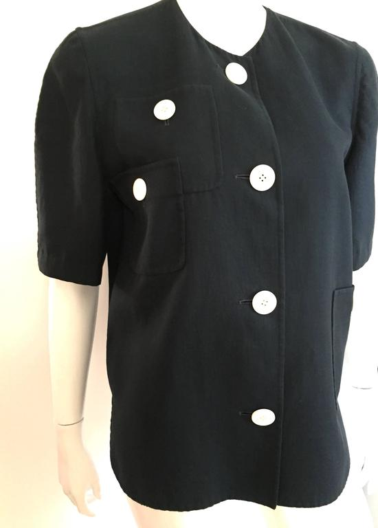 Bill Blass 1980s navy cotton whimsical design short sleeve top with big white round buttons is a vintage size 10.  Ladies please use your tape measure so you can properly measure your bust to make certain this is how Bill Blass wanted it to look on