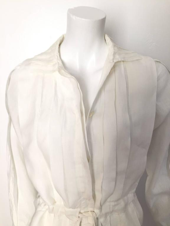 Laura Biagiotti for Bonwit Teller 1980s white linen pleated button up dress with draw string at waistline is an Italian size 40 and fits like a modern USA size 4 / 6 but please see & use the measurements below so you can properly measure your body.