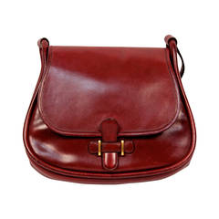 1974 HERMES burgundy box leather saddle bag with gold hardware