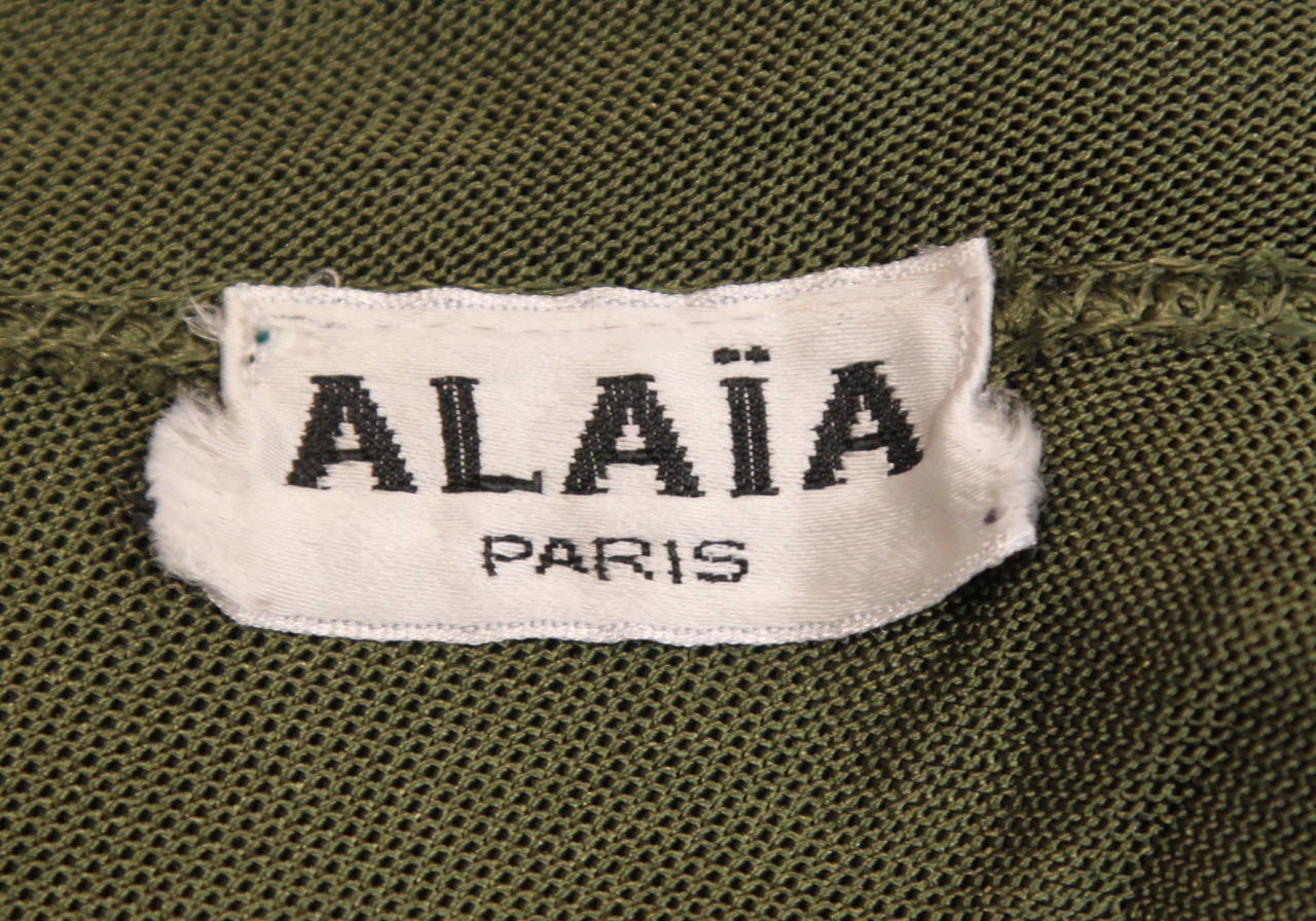 Black 1986 AZZEDINE ALAIA olive viscose hooded dress For Sale