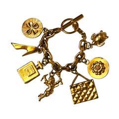 Iconic 1980's CHANEL gilt charm bracelet