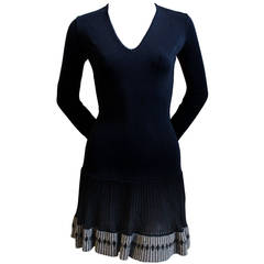 AZZEDINE ALAIA black mini dress with ruffled hemline