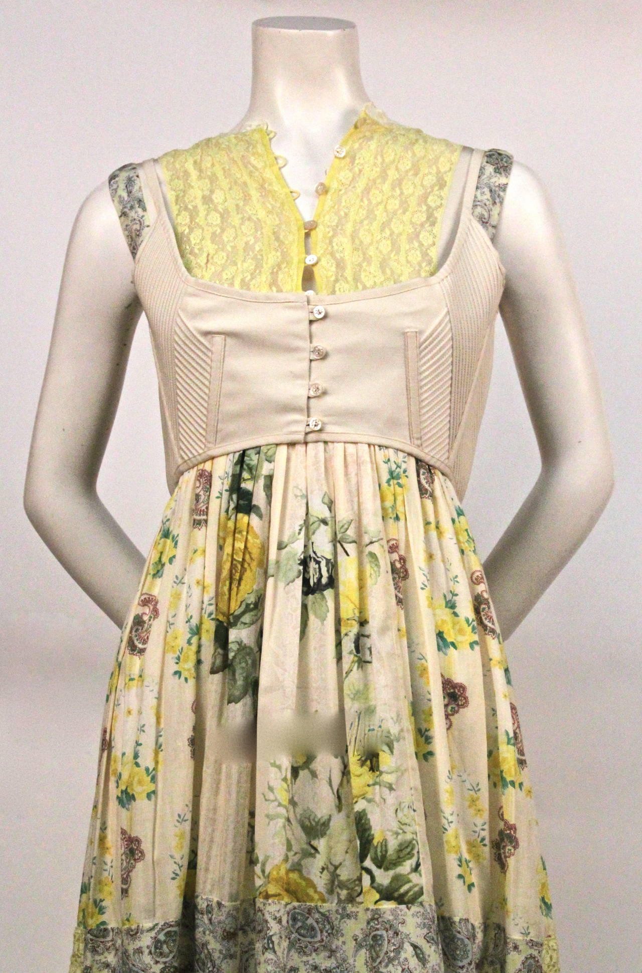 Very rare floral patchwork dress with bustier vest from Alexander McQueen from the 'It is only a game' collection dating to spring of 2005. Exactly as seen on the runway. Italian size 44. Made in Italy. Excellent condition.