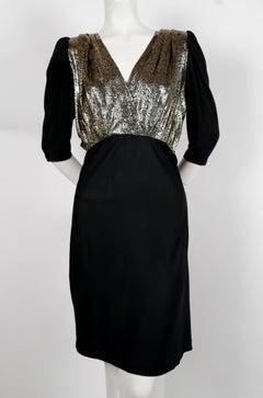 1970's YVES SAINT LAURENT black silk jersey dress with metallic bodice
